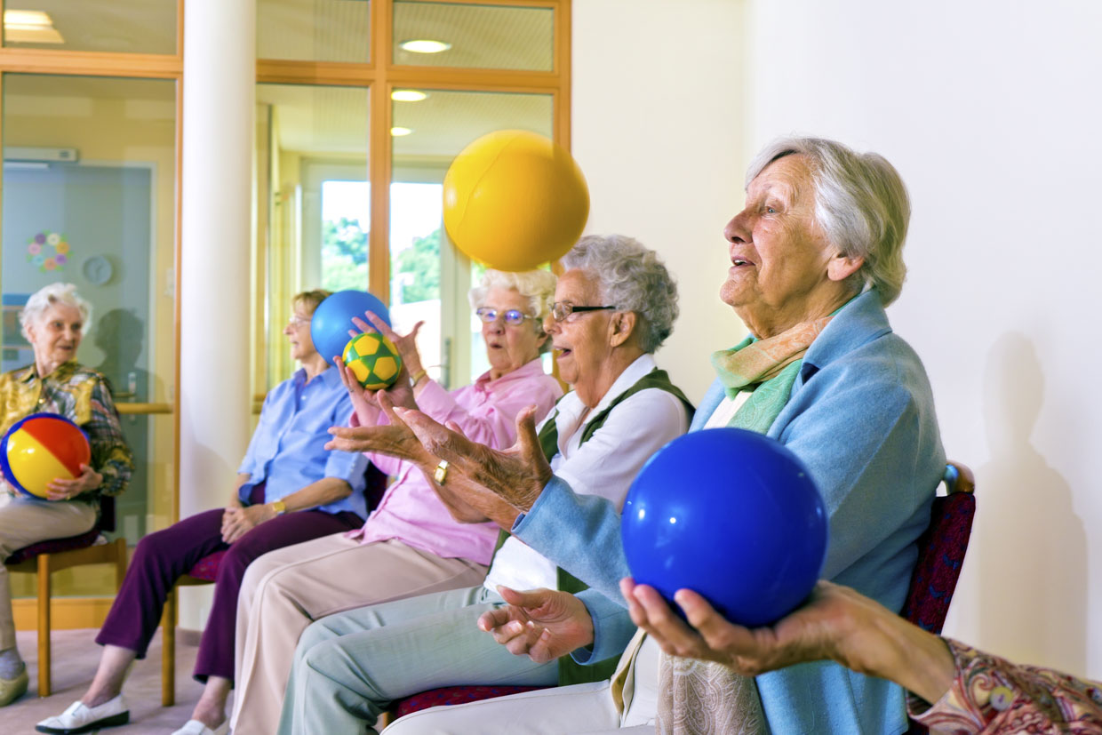 Seated Parkinson's Lancashire exercise with ball